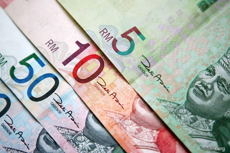 Ringgit halts five-day gain as dollar rebounds