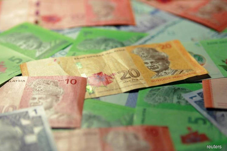Ringgit falls as surging UST yield curbs demand