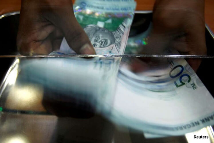 Ringgit declines as global risks sap demand