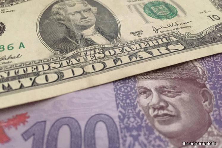 Ringgit falls on dollar strength, Norway plan