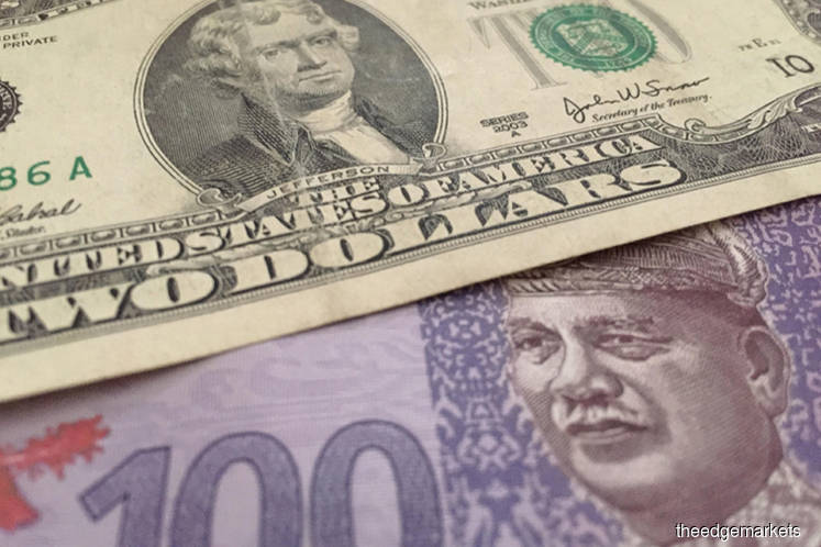 Ringgit lower against US dollar in early trade