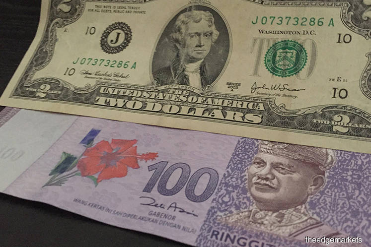 Ringgit slightly lower against US dollar at opening