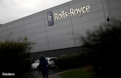 Rolls-Royce shares jump on profit upgrade, bribery settlement