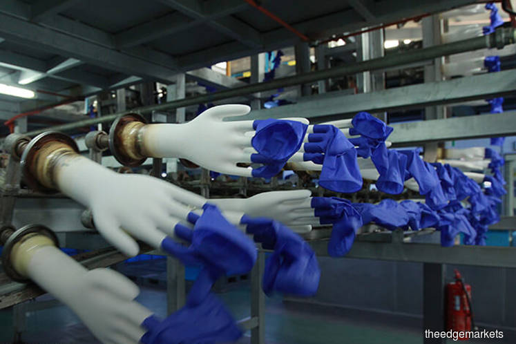 Rubber glove counters rise on weakening ringgit
