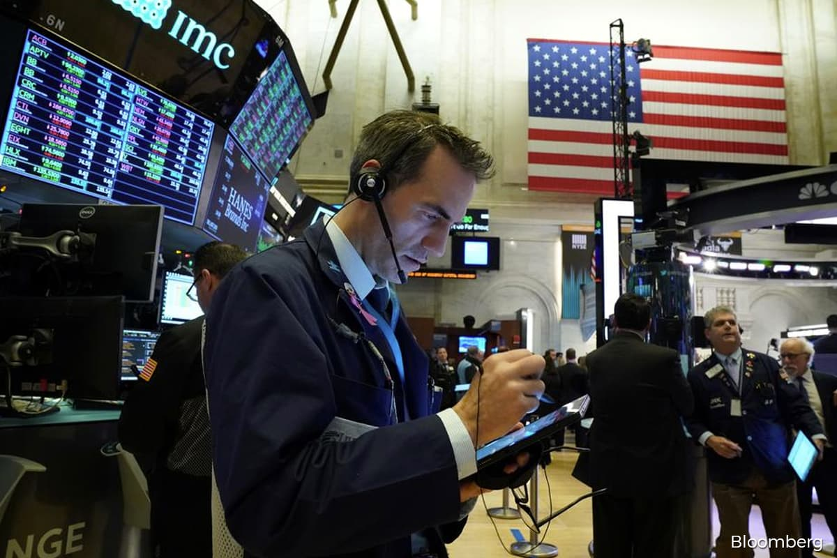 Dow hits milestone, S&P breaks record high on tech rally