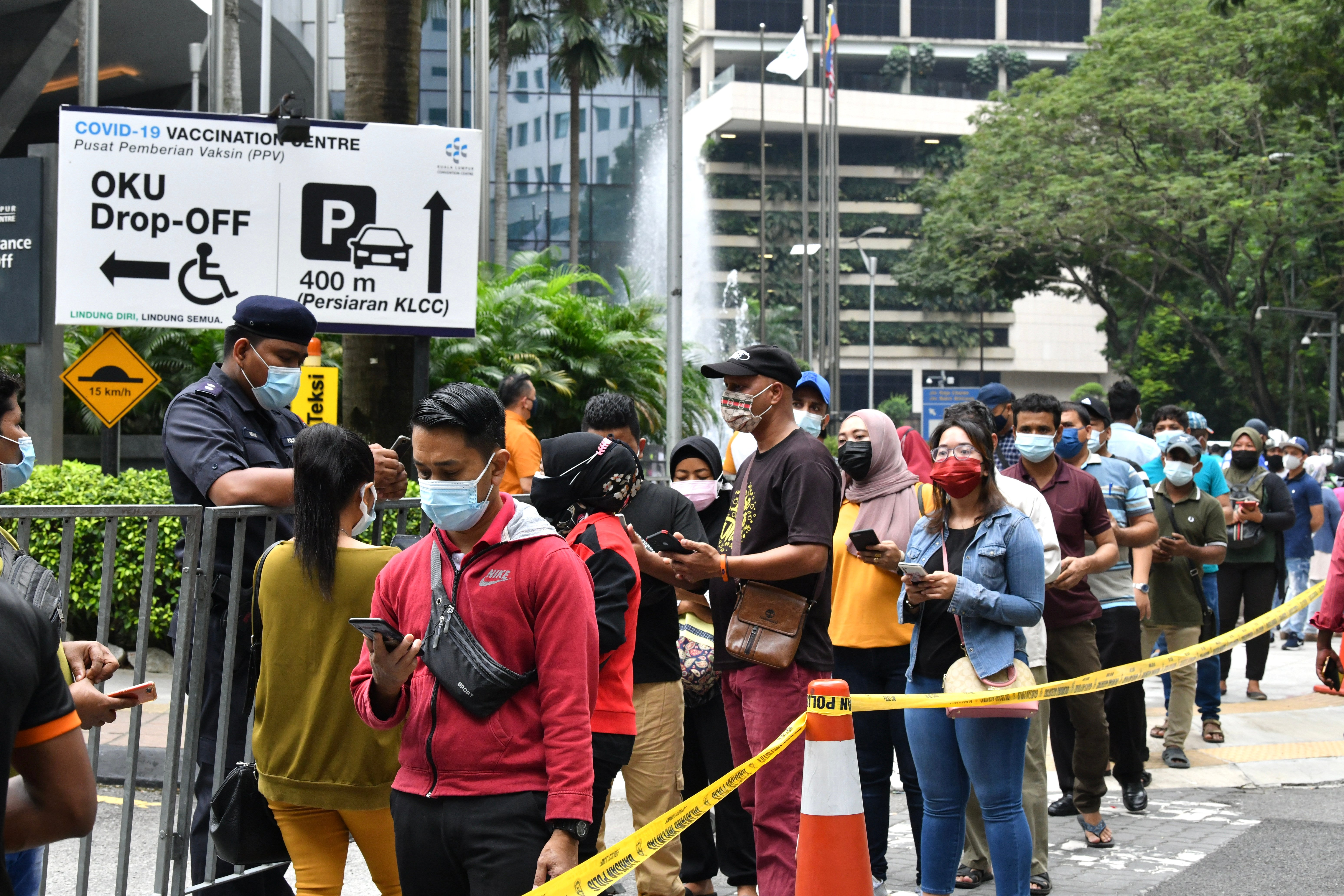 Foreign workers are seen queuing for their Covid-19 shots at the KLCC vaccination centre on July 29. a total of 468,526 doses of Covid-19 vaccine were given yesterday (Aug 2), down from the 480,112 doses of vaccines administered the day before. (Photo by Sam Fong/The Edge)