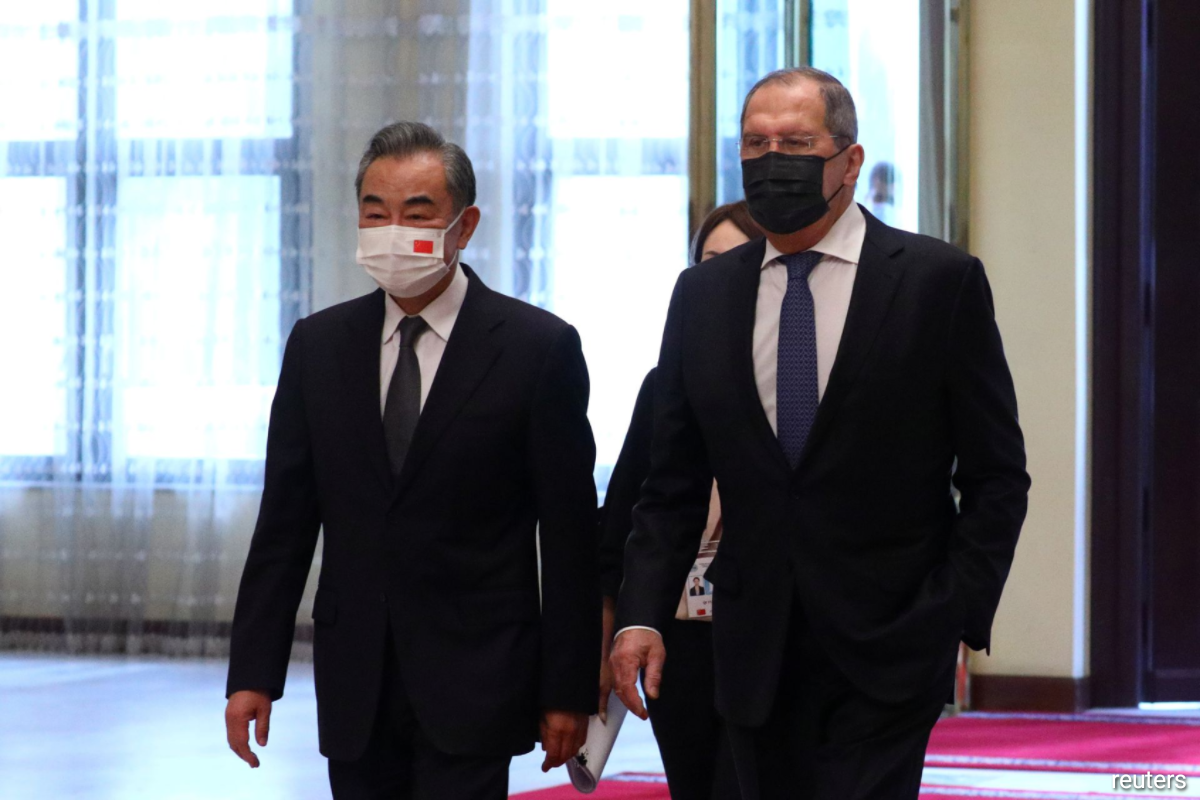 Russian Foreign Minister Sergei Lavrov and Chinese State Councillor and Foreign Minister Wang Yi arrive at the Shanghai Cooperation Organisation (SCO).