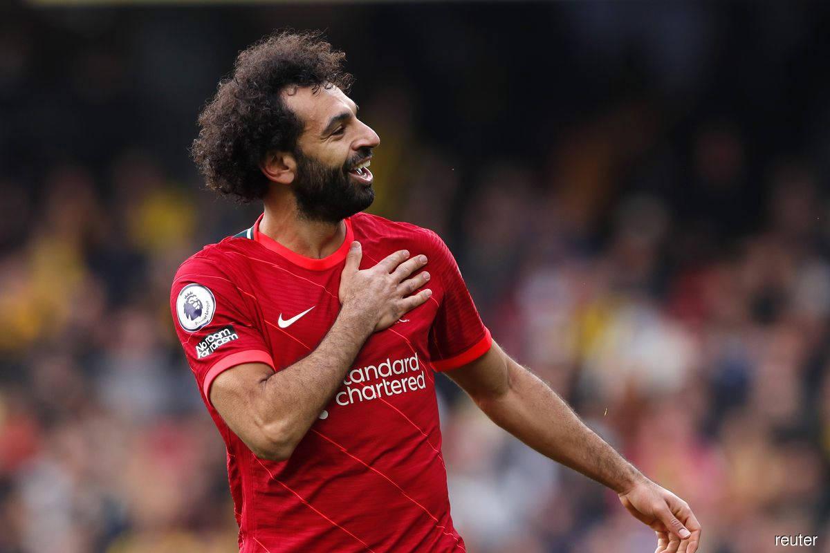 Salah sets more milestones as Liverpool survive Madrid scare