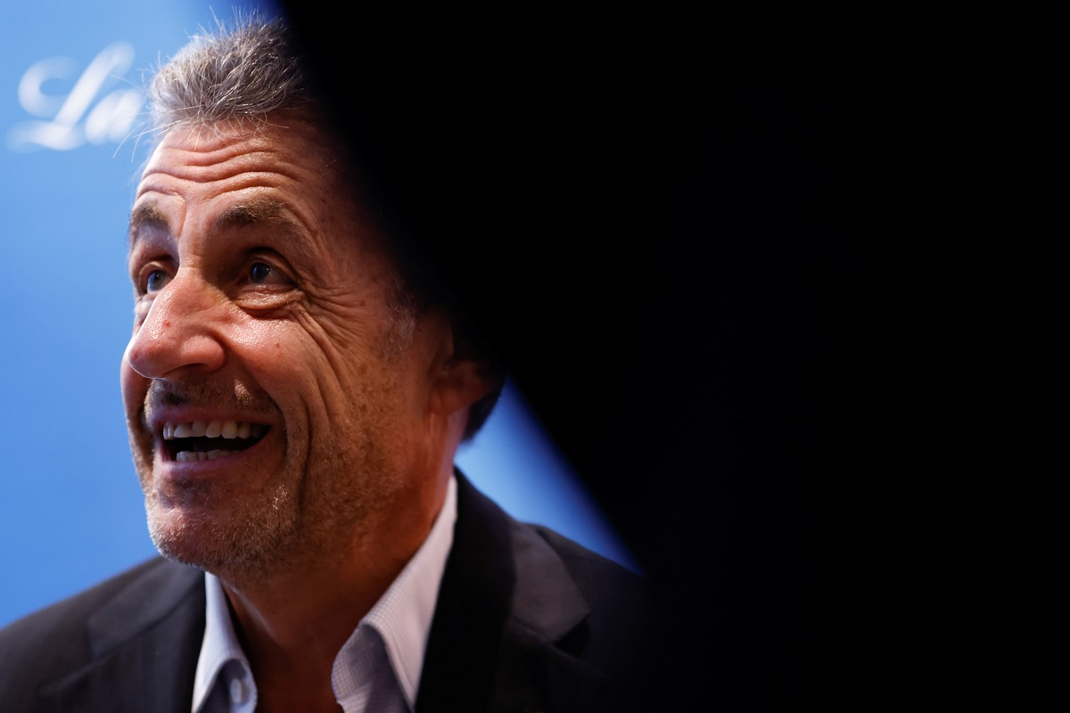 France's Sarkozy plays down new conviction at book signing event