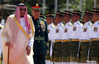 Saudi king signs range of deals in Indonesia at start of visit