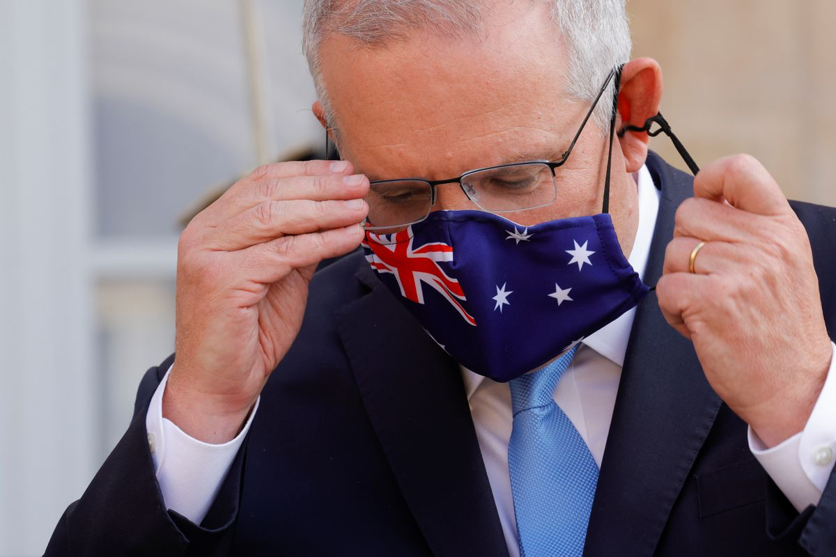Australian PM apologises for Covid-19 vaccine delays as cases spike