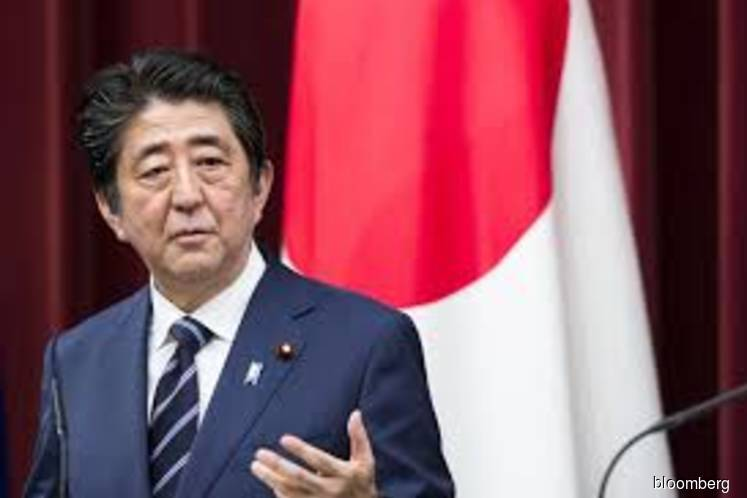 With Trump's blessing, Japan looks to mend ties with Iran