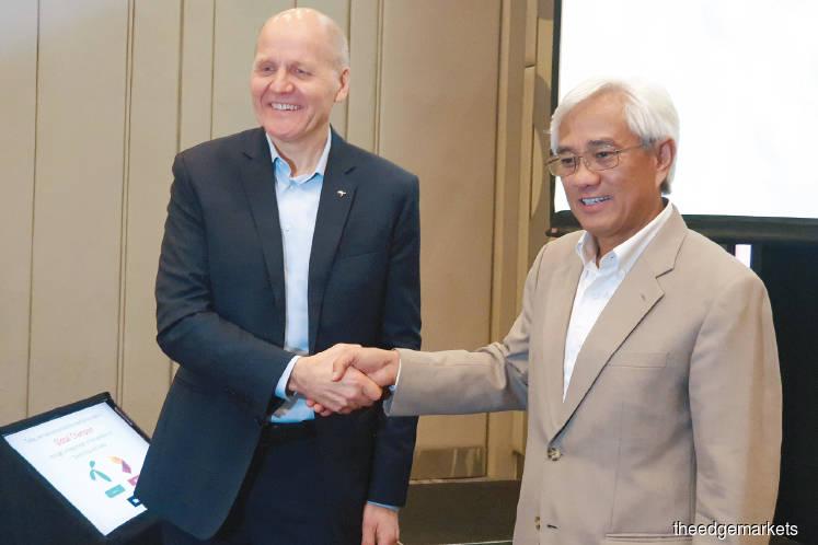 Feature: Axiata, Telenor's audacious mega merger a pan-Asian game changer