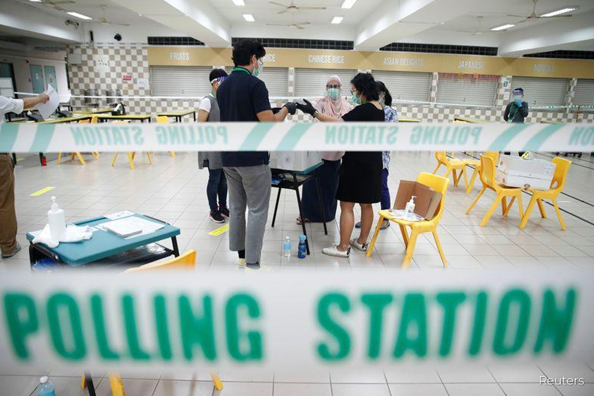 Personnel prepare ballot boxes at a polling station during Singapore's general election in Singapore July 10, 2020. (Photo by Reuters)
