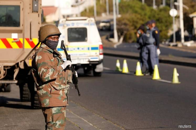 S.Africa struggles to adapt to lockdown after first coronavirus deaths