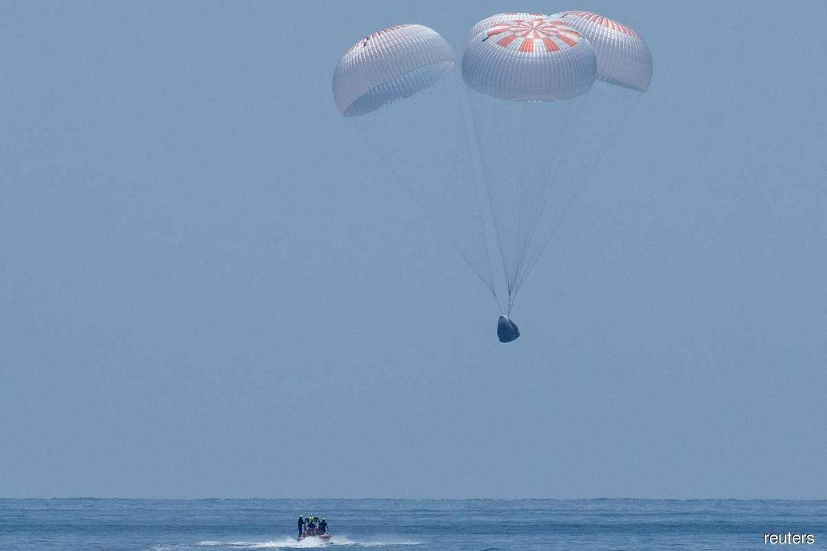 NASA astronauts splash down after journey home aboard SpaceX capsule
