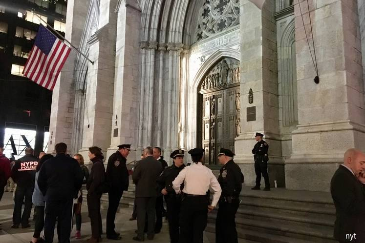 Man caught walking into New York cathedral with gas cans, lighters