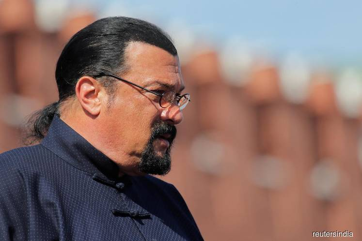 FILE PHOTO: U.S. actor Steven Seagal watches the Victory Day parade, marking the 73rd anniversary of the victory over Nazi Germany in World War Two, at Red Square in Moscow, Russia on May 9, 2018. (Photo by Maxim Shemetov/REUTERS)