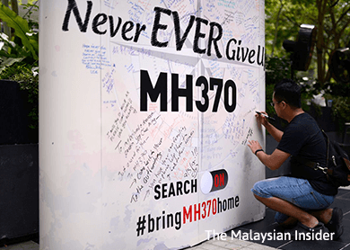 MH370 families want search broadened