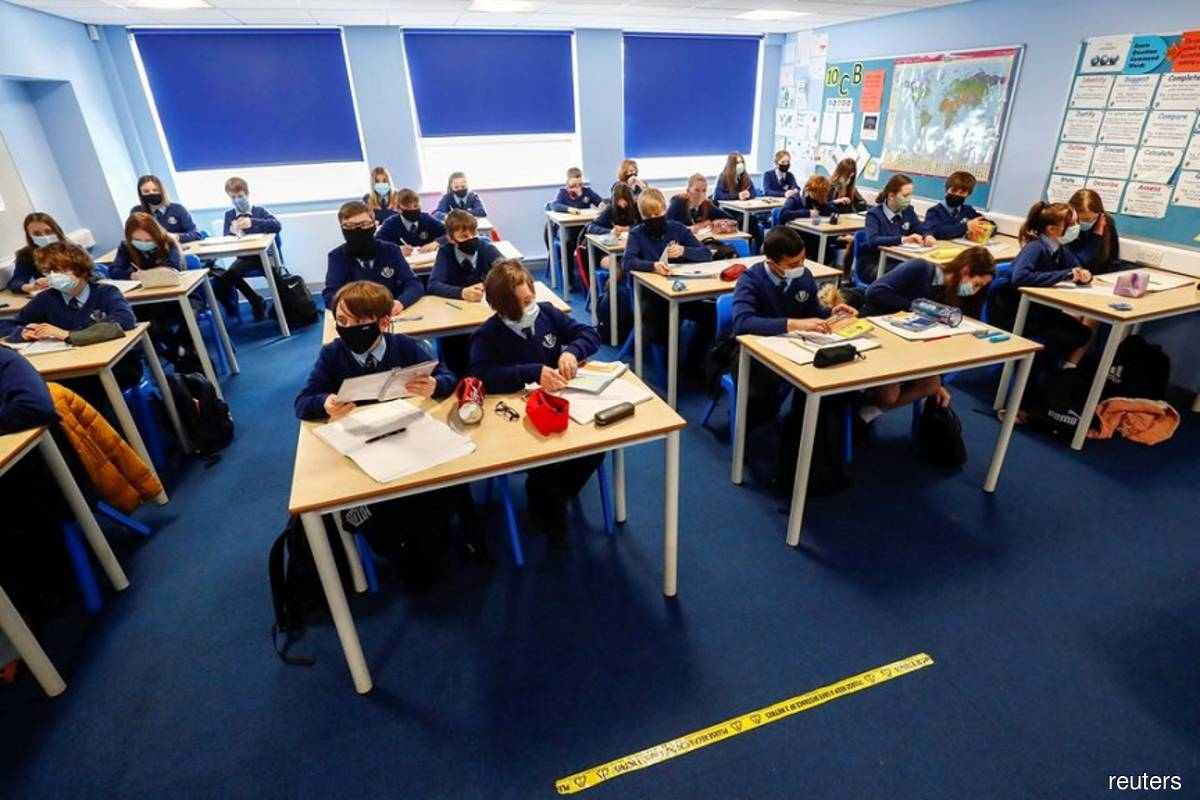 Students attend a lesson at Weaverham High School as the coronavirus disease (Covid-19) lockdown begins to ease in Cheshire, Britain on March 9, 2021. (Photo by Jason Cairnduff/Reuters filepix)