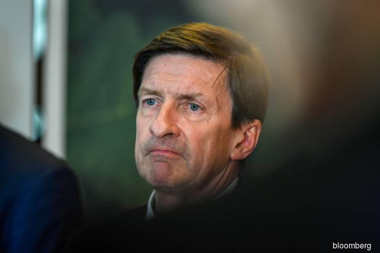 Swedbank chairman quits as scandal rips through top ranks