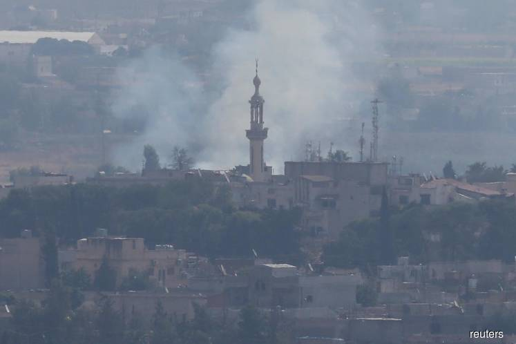 Shelling heard around Syrian town after Turkish-U.S. ceasefire deal