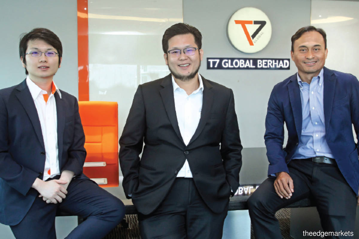 Our financial performance is still growing steadily as we have adapted well to the major changes in the business landscape, says Kay Vin (centre), flanked by Kay Zhuin and Azman. (Photo by Kenny Yap/The Edge)