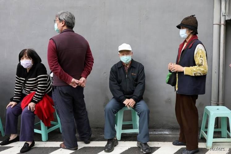 Taiwan coronavirus cases jump again, second death reported