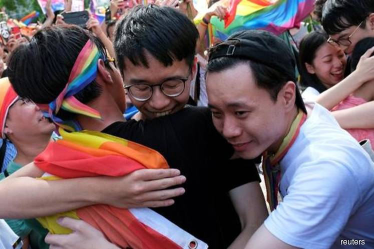 Taiwan man behind Asia's first gay marriage law urges others to fight
