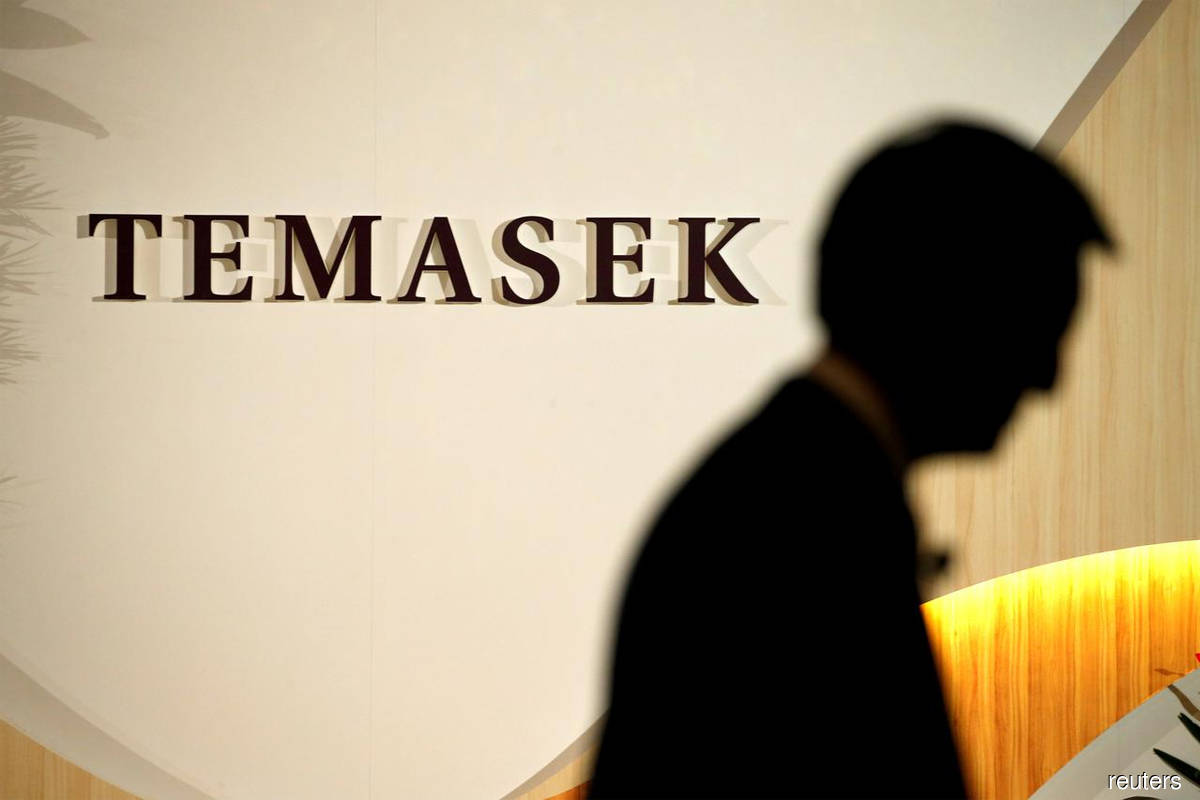 Temasek's private investments rise to record, flags cautious environment
