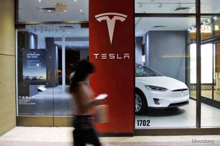 Tesla Plunges on Quarterly Loss, Backtrack From Profit Forecast