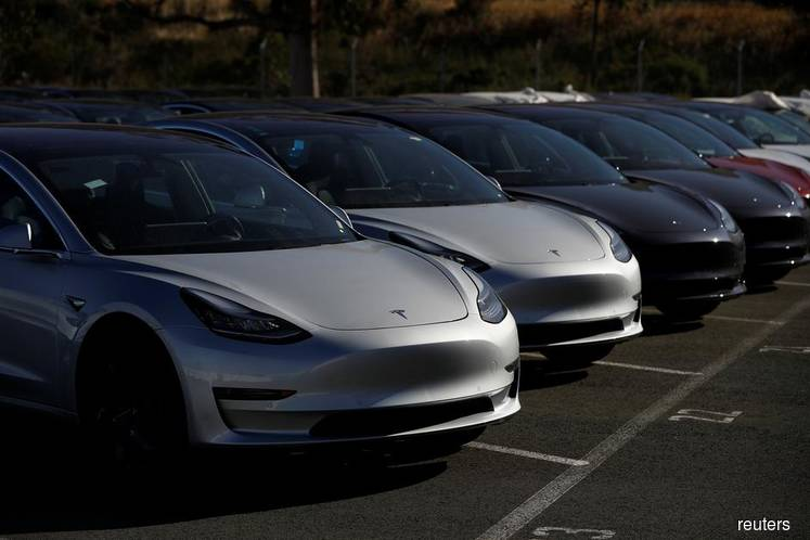 Tesla Soars as Model 3 Paces Record Quarter of Deliveries
