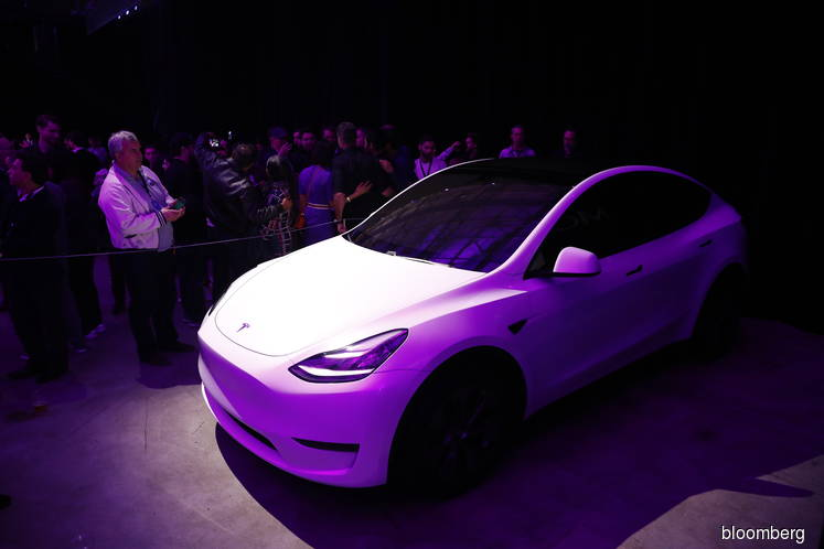 Tesla's Profit and Model Y Arrival Send Stock Soaring Past $600