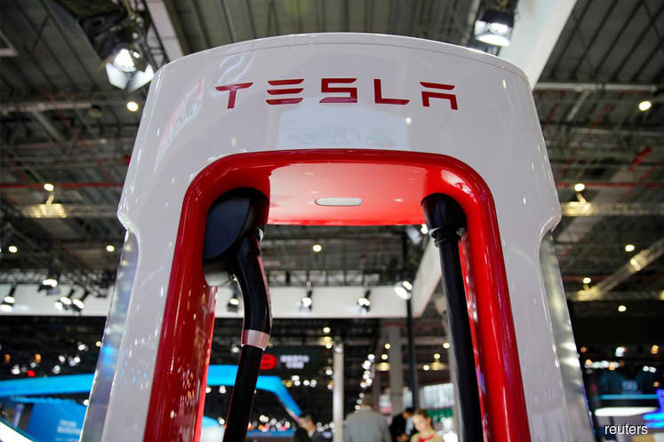 Tesla's China production to start, eyes on mass production timing-sources