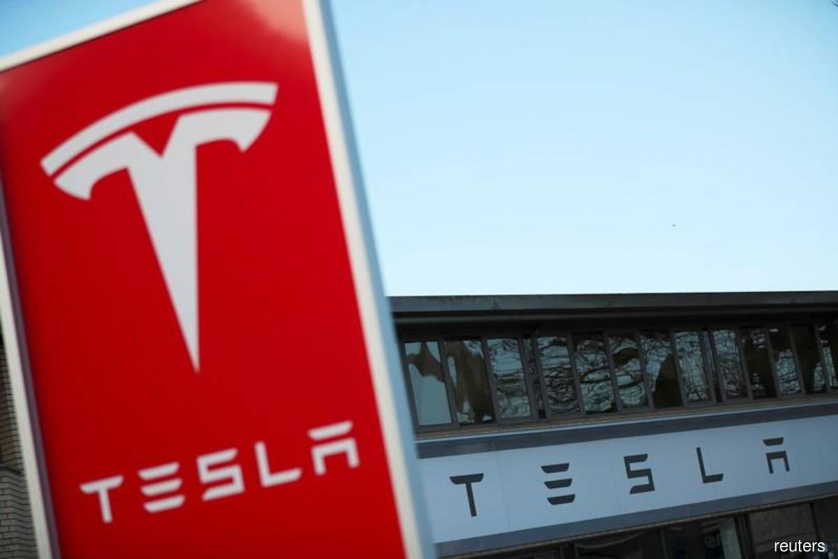 Tesla lifts Wall Street to close at record highs