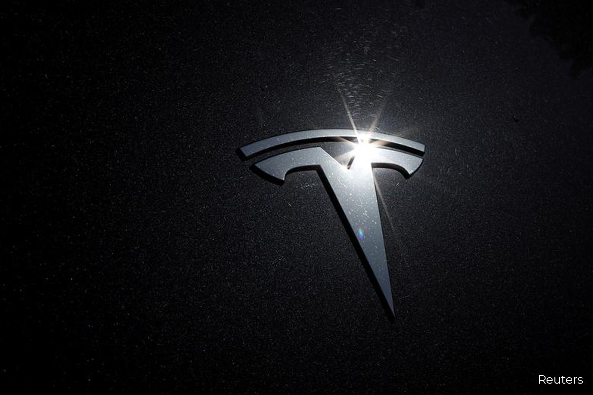 Tesla to join S&P 500, shares surge