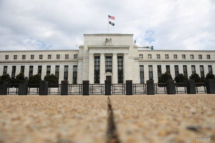 Big central banks move to wait-and-see mode