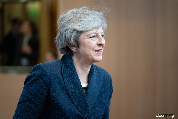 Theresa May begs Tory MPs to unite to deliver Brexit