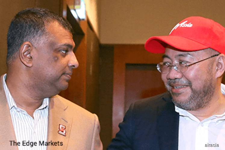 BDO Governance Advisory Sdn Bhd, appointed by the board committee of AirAsia Group Bhd and AirAsia X Bhd (AAX) to assist in undertaking an independent review on corruption allegations related to the Airbus scandal against their co-founders Tan Sri Tony Fernandes (left) and Datuk Kamarudin Meranun, has given the duo the all clear. (Filepix by AirAsia)