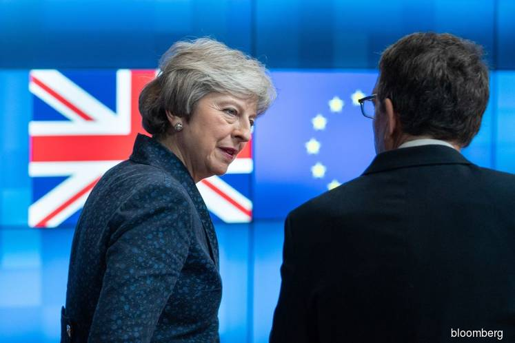 Tories give May breather amid 'difficult' talks