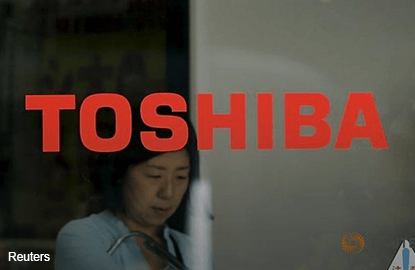 Toshiba falls to six-year low