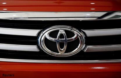 Toyota raises full-year profit outlook on weaker yen, cost cutting