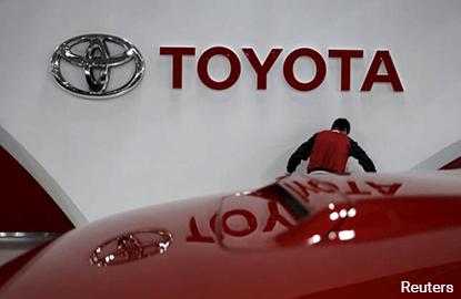 Toyota braces for US trade tension, raises profit forecast