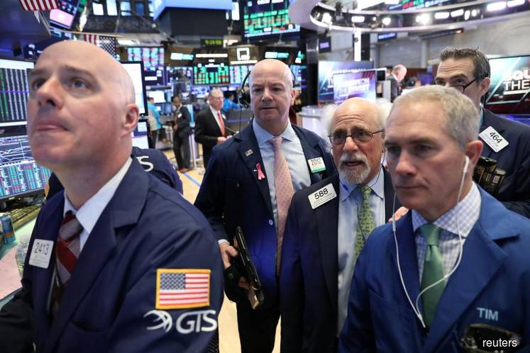 Wall St breaks run of gains as economic data disappoints