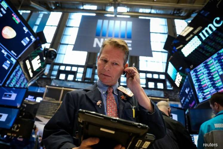 Wall St slips as GE swoons, key market level looms