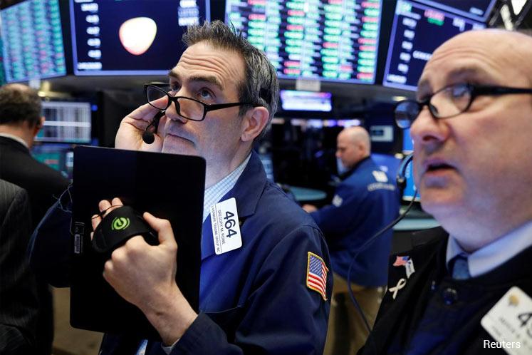 Wall Street ends down as Treasury yields fall on slowdown worries
