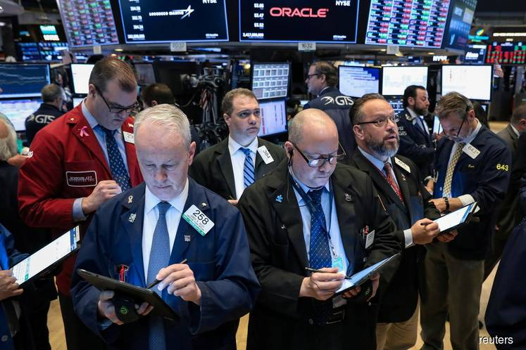 Wall St ekes out gains as investors shrug off Fed minutes