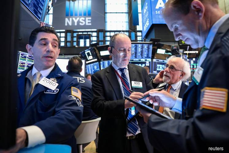 Wall Street slips as bank earnings disappoint