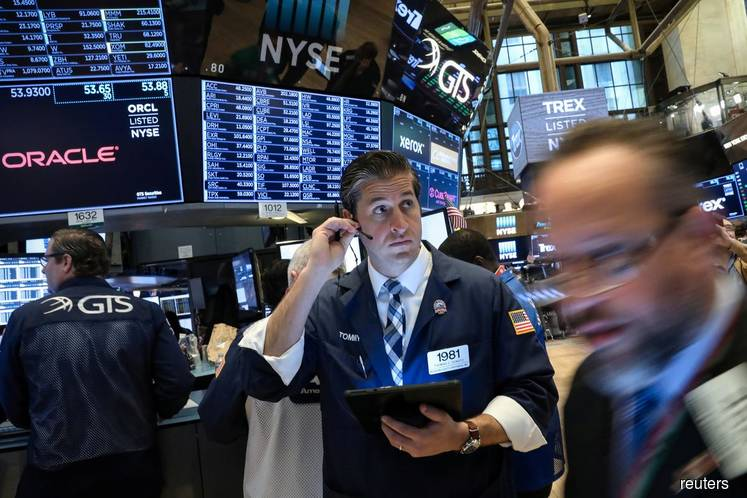 Wall St edges higher on generally positive earnings