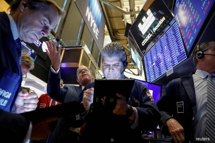 Solid data, trade hopes lift Wall St to records